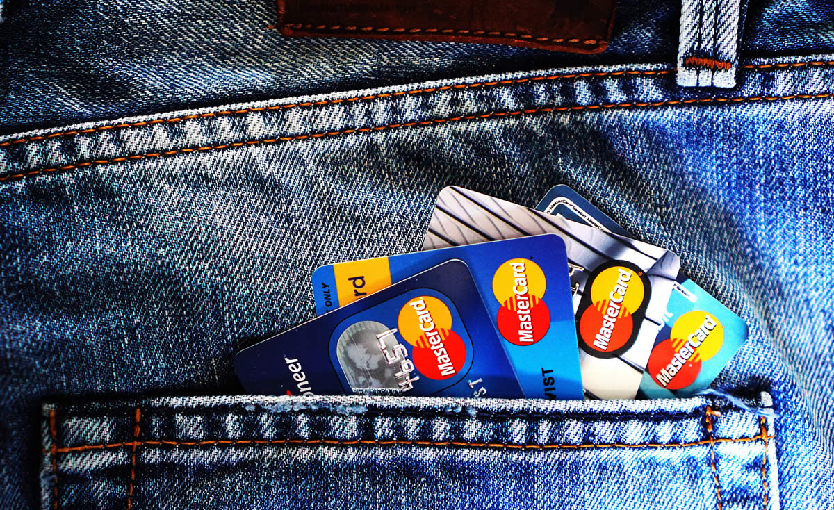 credit cards sticking out back pocket on pair of blue jeans