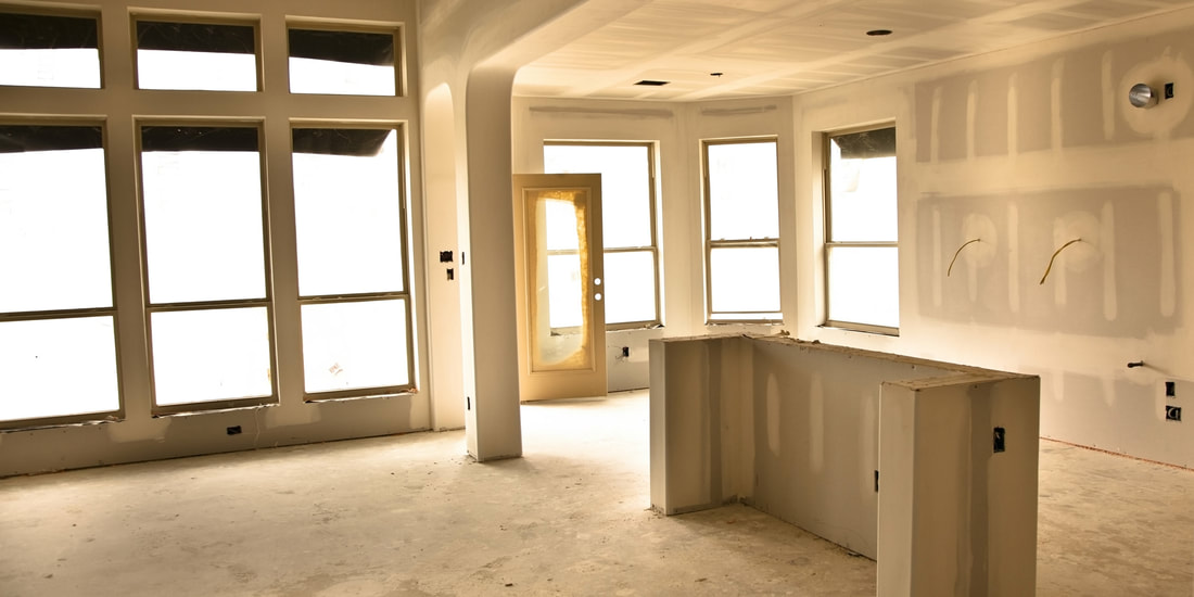 Kitchen with only sheetrock in place